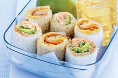 Sandwich sushi - bread rolls with:  1) creamed corn, ham, cucumber and carrot  2) salmon, lettuce and avocado