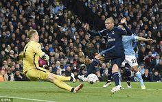 England international stopper Hart makes a crucial save from Real Madrid defender Pepe (ri...