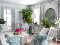 This small living room was enhanced and visually expanded by covering the walls, trim and ceiling in different shades of seaglass tones and using properly-scaled furniture.Small Living Room Ideas | Living Room and Dining Room Decorating Ideas and Design | HGTV
