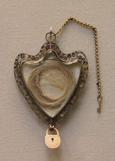 """""""This interesting locket is said to contain a lock of Marie Antoinette's hair. Legend has it that it was given by the Queen to a Lady Abercorn. It is now held at the British Museum, London.""""  Nice example of hair given as a token, not as a death memento."""