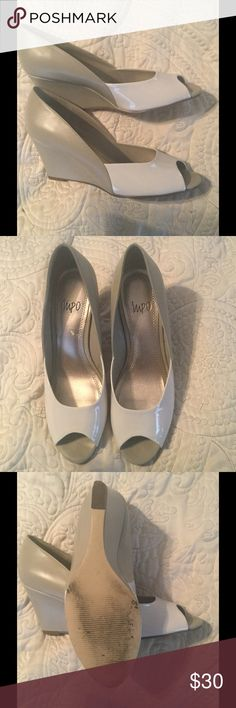 Impo taupe peep toe wedge shoes 7 1/2 Impo two tone taupe peep toe wedge shoes size 7 1/2 . Gently worn . Lighter beige I front of shoe is patent. Back is darker beige I. Leather .shoes in great condition . Tiny scuff on one heel. Barely noticeable. impo Shoes Wedges