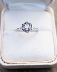 How special is this ring? SO special. ✨ From the reclaimed vintage modified hexagonal cut Diamond to the precision cut Sapphire halo, this is one unique creation. All it needs now is a love story ❤️!