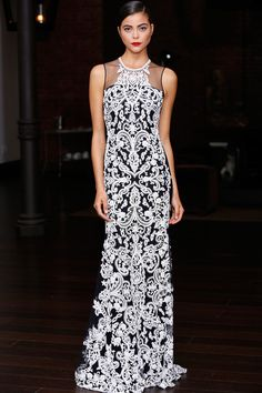 RESORT 2014 Naeem Khan /  Naeem Khan knows how to take a woman's breath away, which is why the designer's well-heeled customers (ranging from such starlets as Taylor Swift and Emmy Rossum to the First Lady herself) regularly turn to him for eveningwear to make memories in. As usual, Khan's Resort lineup included plenty of dazzling numbers for those moments when the red carpet is rolled out and the flashbulbs are popping.