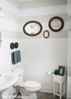 bathroom stripes beadboard white coastal neutral via The Lilypad Cottage