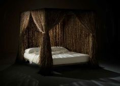 large bed with rain curtains made of palm tree fiber #eco