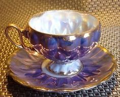 Beautiful-Luster-Iradescent-Footed-Teacup-Saucer-Fan-Crest-China