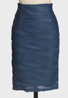 More Than Words Pencil Skirt In Blue 42.99 at shopruche.com. Crafted in a classic and universally flattering silhouette, this  elegant blue pencil skirt is rendered in a beautifully textured knit  with undulating waves of fabric. Finished with a hidden back zipper  closure, a kick pleat for graceful...