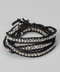 Wrap either wrist with this edgy accessory and consider an evening ensemble rock concert-ready! Crafted from genuine leather, it creates a unique layered design that shines bright with metallic metal beads.28'' longLeather / metalImported