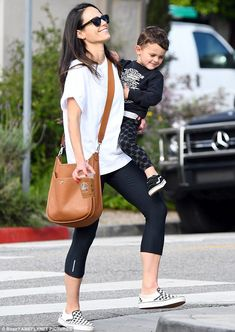 A step up:Jordana Brewster was spotted carrying an iced coffee while holding her son Juli...