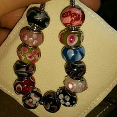 925 STAMPED BEADS 13 BEADS 12 ARE GLASS (I BELIEVE THE RED AND PINK IS A BAKED CLAY) WILL FIT DESIGNER BRACELETS PLEASE ASK ALL QUESTIONS BEFORE BUYING BEADS ARE HAND BLOWN AND MAY HAVE SMALL IMPERFECTIONS BUT ARE STILL VERY PRETTY Jewelry