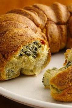 Little spinach and cheese filled pastry balls are baked together and inverted on a plate for a foolproof appetizer.