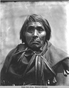 Southeast Alaska--Tlingit Taku Indian doctor wearing necklace [perhaps baleen] and blanket trimmed with deer hooves, c. 1900. Alaska's