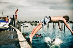 youths diving off a pier