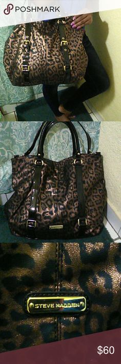 """Steve Madden Bag This bag features leopard print with shimmer, black straps wirh gold tone hardware, snap closure for easy access, removable shoulder strap. Inside zipper pockets with lots of room. Measures 19""""w x 14"""" h with a 20"""" drop from the handle. Very versatile bag. Like new. Offers welcome. Steve Madden Bags"""