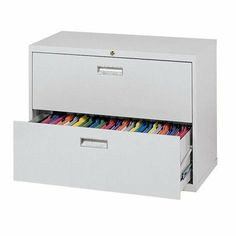 """600 Series Lateral File Cabinets Color: Primary Green, Size: 54"""" H x 36"""" W x 19.25"""" D by Sandusky Cabinets. $472.99. 17088-A8 Color: Primary Green, Size: 54"""" H x 36"""" W x 19.25"""" D Features: -Lateral file cabinet.-Aluminum handles with steel reinforced drawer fronts.-Full drawer extension using three telescoping sections operating on steel ball bearings slide suspension.-Rolled edge drawer sides for strength, rigidity and safety.-Anti-tipping interlocking system and co..."""