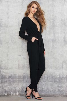Drop it like it's hot! The Knot Jumpsuit by NA-KD Trend is made in black Polyester. It has a deep neckline, fitted waist and pockets.  We love this hot jumpsuit!