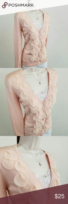 LOFT cardigan with cascading petals Long-sleeved button front cardigan with a cascade of fluttering petals in pale pink.  Soft and feminine.  Bust 18 / length 24.5 inches.  100% cotton.  Thanks for visiting my closet!  I add listings every week; come back soon & see what's new! LOFT Sweaters