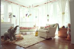 This is so beautiful. I love all the light and white and then just simple accents of pink. So cheery