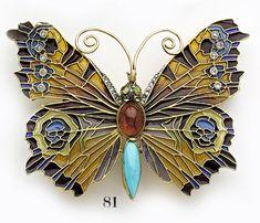Art nouveau plique-à-jour enamel, rose-cut diamond, turquoise, garnet, peridot and gold butterfly brooch/pendant.