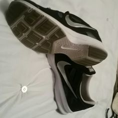 Women's Nike Trainer tennis shoes Size 9.5.  Black, white & silver.   Only worn a couple of times Nike Shoes Athletic Shoes