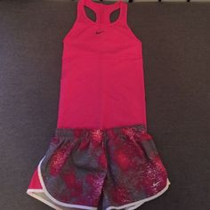 Nike running outfit Pink top, grey bottoms with splatters of pink. Dri fit top, perfect for working out. Nike Other