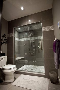 Chic Beautiful Small Bathrooms with Brilliant Setting Ideas: Dark Bold Brown Towel On The Storage And White Porcelain Toilet Design In Beautiful Small Bathrooms With Screened Shower And Grey Tile Backsplash Mosaic Wall ~ HKSTANDARD Bathroom Designs Inspiration