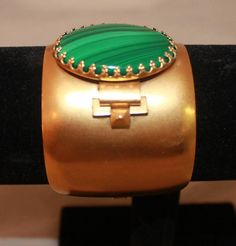 Ela Stone Malachite Gold Cuff | From a unique collection of vintage cuff bracelets at https://www.1stdibs.com/jewelry/bracelets/cuff-bracelets/