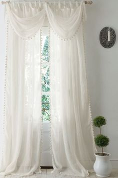 Pom Pom Linen Curtain A fun take on a go-anywhere neutral, our ivory linen curtain receives a playful update with pretty pompom trim. Airy and light, the sheer panel is beauti