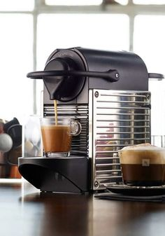 The Pixie Steel Coffee Machine from Nespresso is the perfect stylish kitchen gadget to help wake you up—by brewing cup after cup of silky espresso creations!