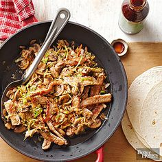 Coleslaw mix, button mushrooms, and some soy sauce dress pork chops up for a healthy, global excursion. Just sizzle everything in a frying pan, warm the tortillas, and this 400-cal dinner's a wrap!