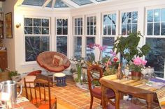 Love the windows!! And the table is close to the one in my mind. .but with a scrabble board instead of the flowers