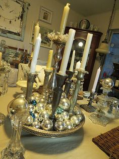 assorted silver candlesticks displayed so well