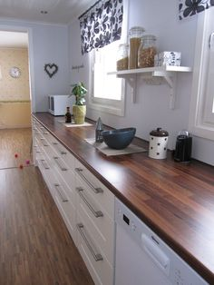 butcher block counter stained dark. I think I'm starting to like this better than any other countertop option!