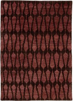 The Azland collection highlights the stunning artisan-made quality of a Persian knot accent. The Sabot hand-knotted area rug is a bold addition to any transitional style living space with an incredibly soft blend of wool and cotton. The timeless appeal of a repeat Moroccan pattern pairs with rich, moody hues of plum and deep brown for a global and simultaneously luxurious look.