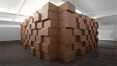 installation by Zimoun; cardboard boxes, motors and cork balls