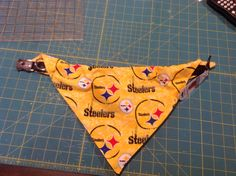 Dog scarf slides right on the collar.