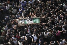 Funeral: Thousands of people gathered in the Gaza Strip 15 November for the funeral of Ahmed Ja'abari, the commander of the military wing of the Palestinian Hamas movement. His casket was being taken to the al-Omari mosque in Gaza City for a prayer service before burial