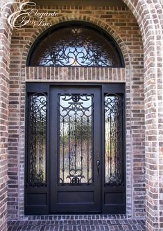 Custom wrought iron door with sidelights and a full arch transom.