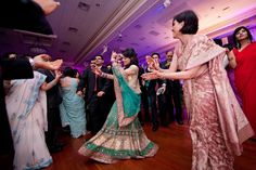 Dancing to a Bollywood number..bride and her mother