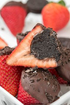 Oreo Truffle Dipped Strawberries - an easy Valentine treat! Stuff strawberries with Oreo Truffles and dip the tops in chocolate!
