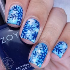 This video tutorial shows how to use nail polish on stamping pad and stamper to create this snowflake-inspired nail art. See the complete list of nail products to DIY.