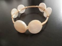 White flat round stones on a gold bangle creates a delicate yet bold look. Match with your favorite bangle colors at www.rocmeout.com