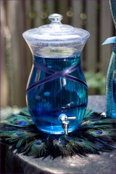 Centrepiece idea? Fishbowls or vases with blue tinted water and white floating candles.