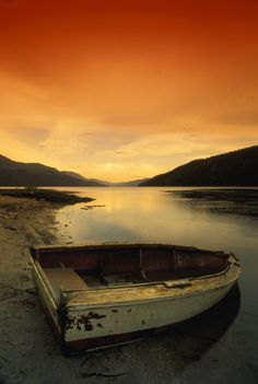 Don Hammond Solid-Faced Canvas Print Wall Art Print entitled Old Rowboat At Water's Edge With Sunset Background, Alberta, Canada Canvas Artwork, Canvas Prints, Art Prints, Nature Posters, Sunset Background, Water, Outdoor, Boats, Photography