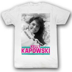 This is an officially licensed Saved by the Bell Kelly Kapowski Mens Tee Shirt in white featuring image of Tiffani Amber Thiessen's character Kelly Kapowski.