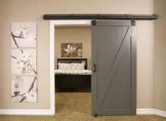 AMAZING barn style door on hinges.  Great for every room, but would be neat for a basement.