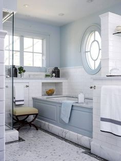 blue millwork and walls, white subway tile, and Carrara marble