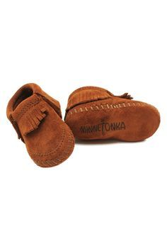 These adorable leather moccasins from Minnetonka are handmade from super soft suede. The elasticized opening that not only makes for easy on and off, but helps keep them in place on those tiny feet! -