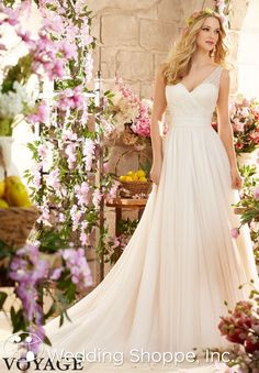 A simple wedding dress made from netting that is comfortable and ethereal.