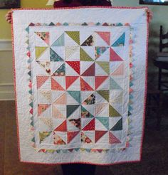 Love how the prairie points were used in this quilt.